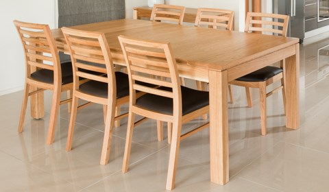 ATTRA DOUBLE EXTN DINING TABLE IN OAK.